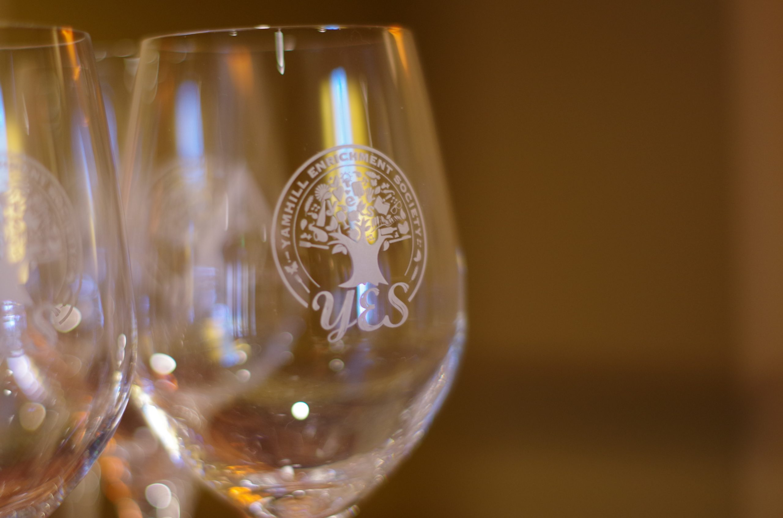 Wine glasses with Yamhill Enrichment Society - YES logo on them