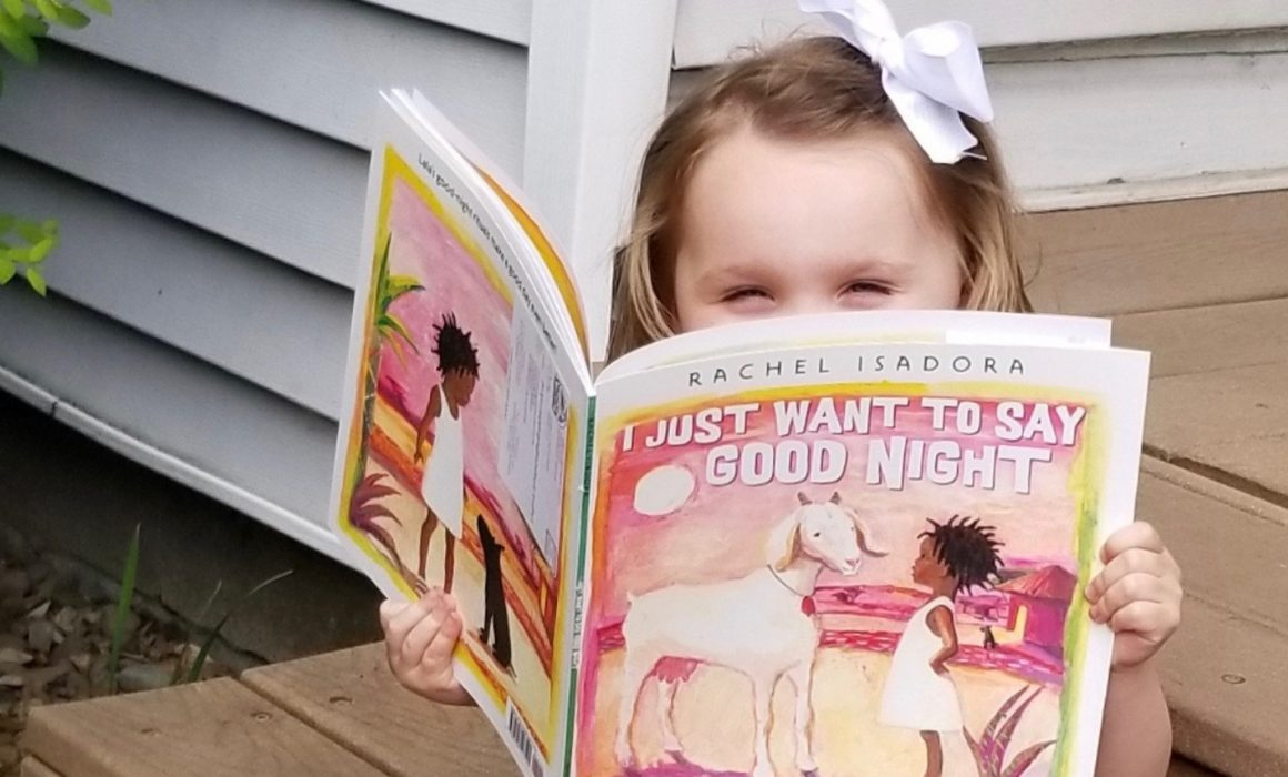 Girl reading I just want to say Good Night by Rachel Isadora